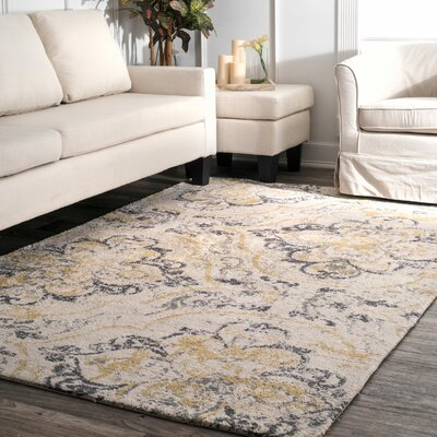 Zanesville Ivory Yellow Area Rug