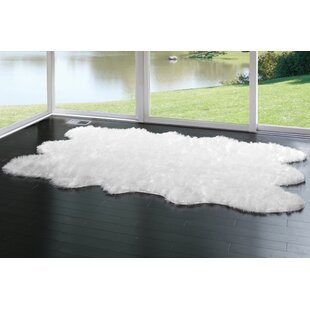 Find the perfect Anvi Faux Fur White Area Rug By Willa Arlo Interiors