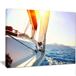 'Sailboat Sailing in the Blue Sea' Photographic Print on Wrapped Canvas by Design Art
