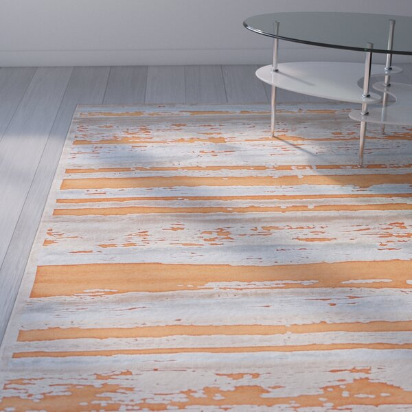 Elvis Orange/Taupe Area Rug by Wade Logan