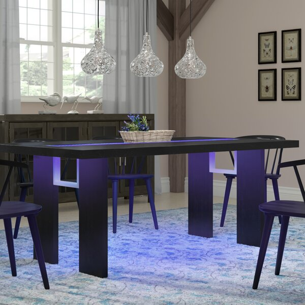 Pelchat Luminate Solid Wood Dining Table by Wade Logan