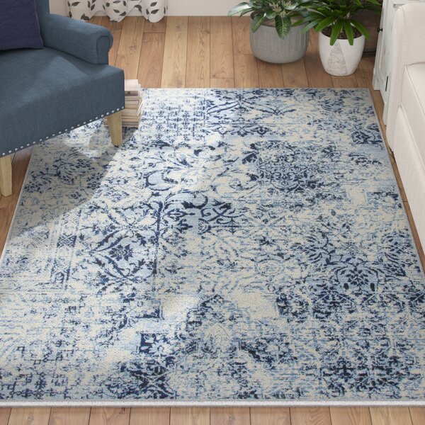 Haylie Ivory Area Rug by August Grove
