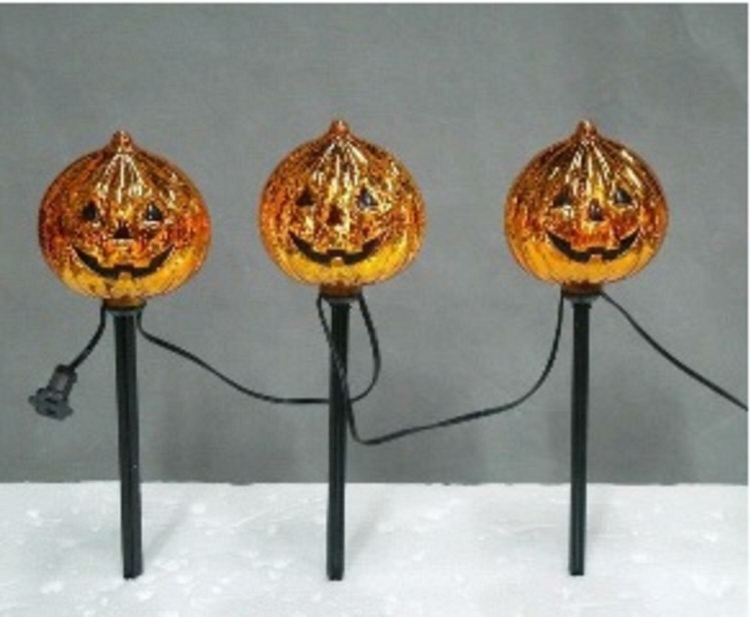 The Holiday Aisle Pumpkin Statue with LED Eerie Night Scene Lighted Display
