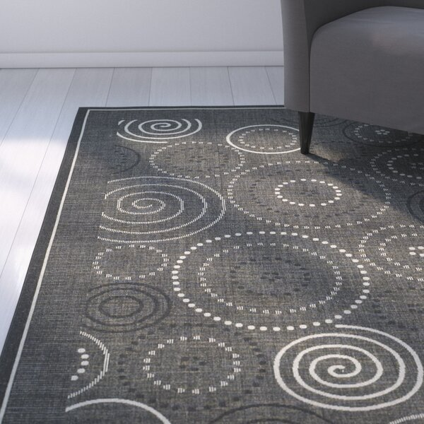 Mullen Black/Sand Circle Indoor/Outdoor Area Rug by Ebern Designs