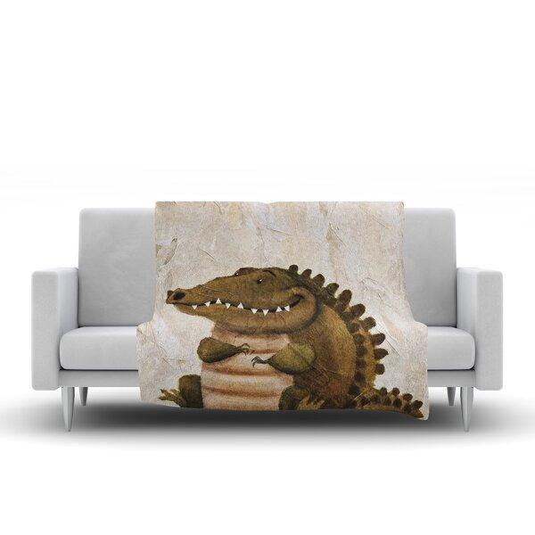 Smiley Crocodiley Throw Blanket by KESS InHouse