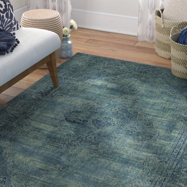 Makenna Turquoise Area Rug by Mistana