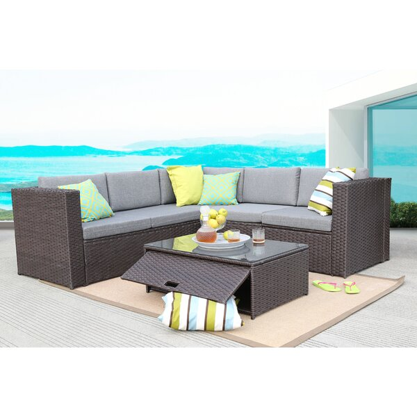 Hansley 4 Piece Rattan Sectional Seating Group with Cushions by Ivy Bronx