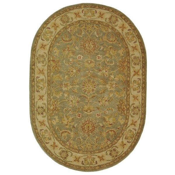 Dunbar Hand-Woven Wool Moss Green/Gold Area Rug by Charlton Home