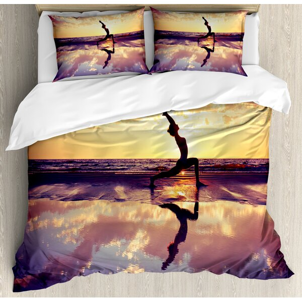 Woman Practicing on Beach Sunset Dramatic Sky Water Reflection Image Duvet Set by East Urban Home