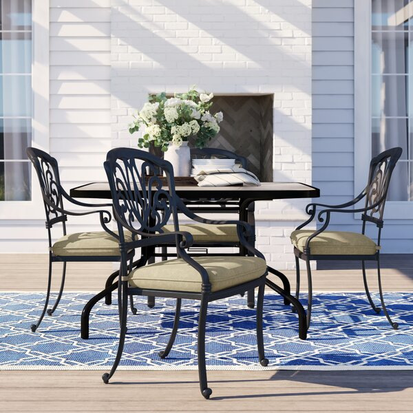 Lebanon Stacking Patio Dining Chair with Cushion (Set of 4) by Three Posts Three Posts