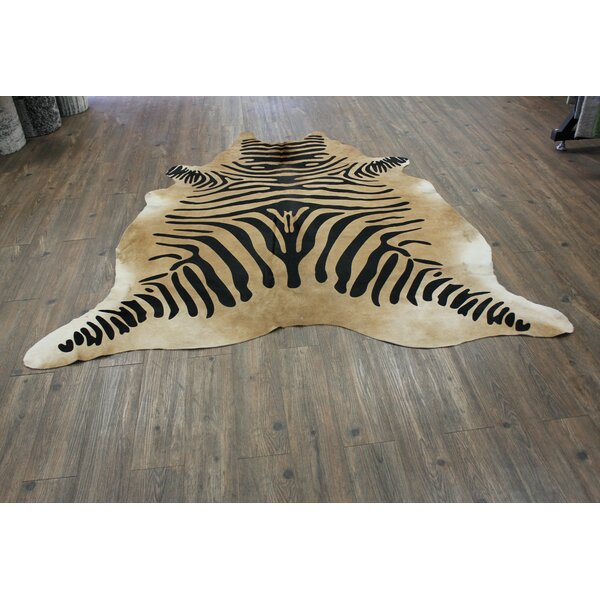 Ducote Stenciled Zebra Hair-on Hand-Woven Cowhide Black/Camel Area Rug by Bloomsbury Market