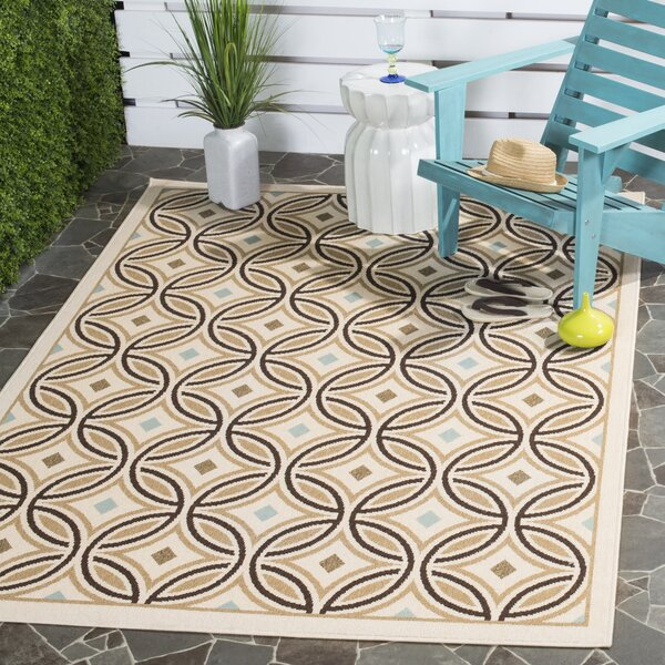 Rennie Cream / Chocolate Indoor/Outdoor Area Rug by Charlton Home