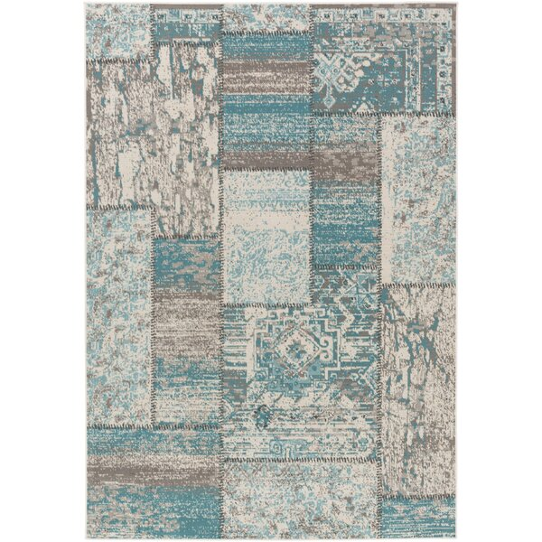 Kimes Turquoise / Ivory Area Rug by Ophelia & Co.
