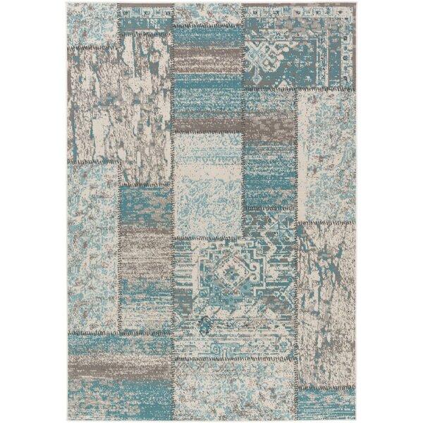 Kimes Turquoise / Ivory Area Rug by Ophelia & Co.
