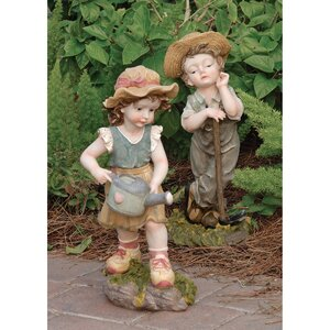 2 Piece Fanny and Frank Farmer Statue Set