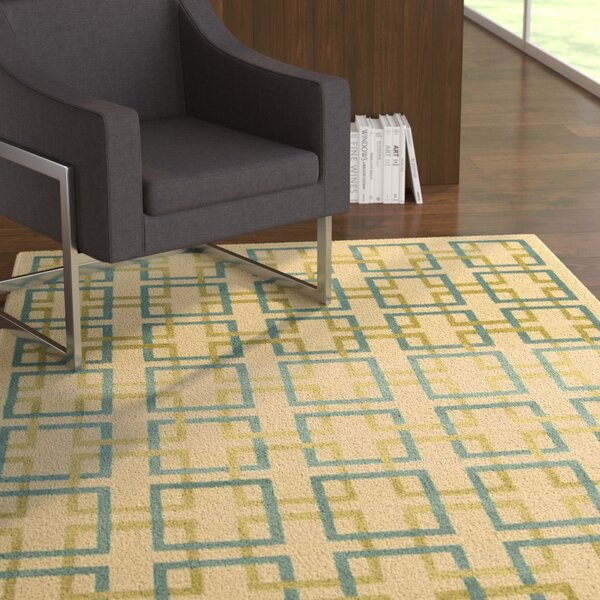 Dennis Ivory/Blue Area Rug by Ebern Designs