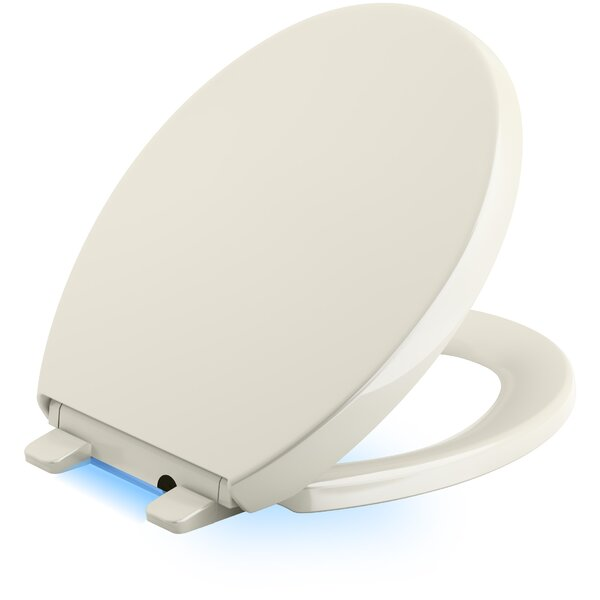 Reveal Nightlight Quiet-Close with Grip-Tight Round-Front Toilet Seat by Kohler