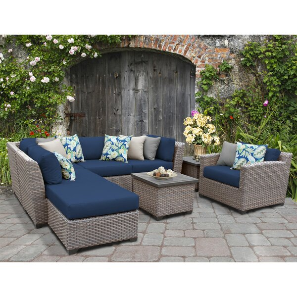 Meeks 8 Piece Rattan Sectional Seating Group with Cushions by Rosecliff Heights