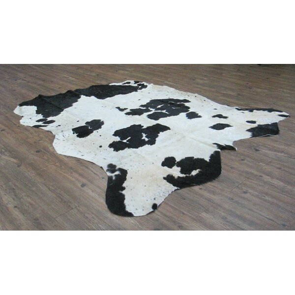 Valora Hand-Woven Cowhide Black/Off-White Area Rug by Loon Peak