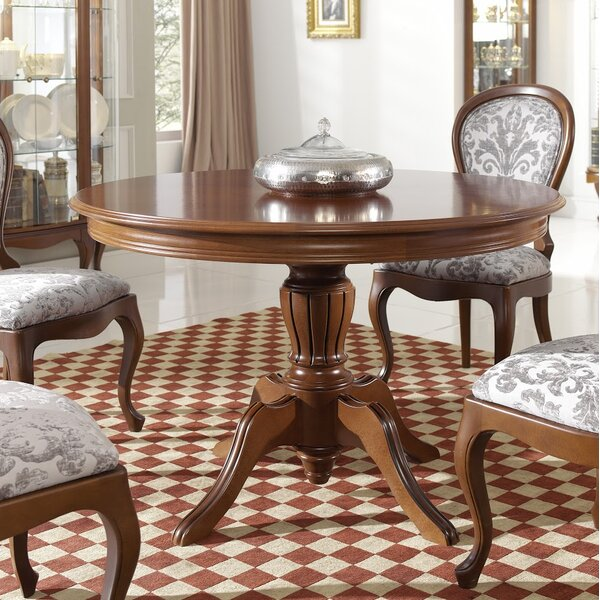 Avalos Round Solid Wood Dining Table by Alcott Hill