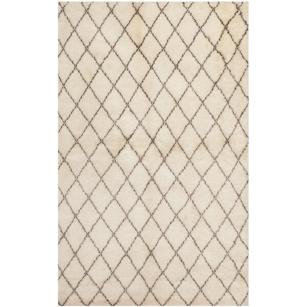 Loft Hand-Knotted Wool Beige Area Rug by Safavieh