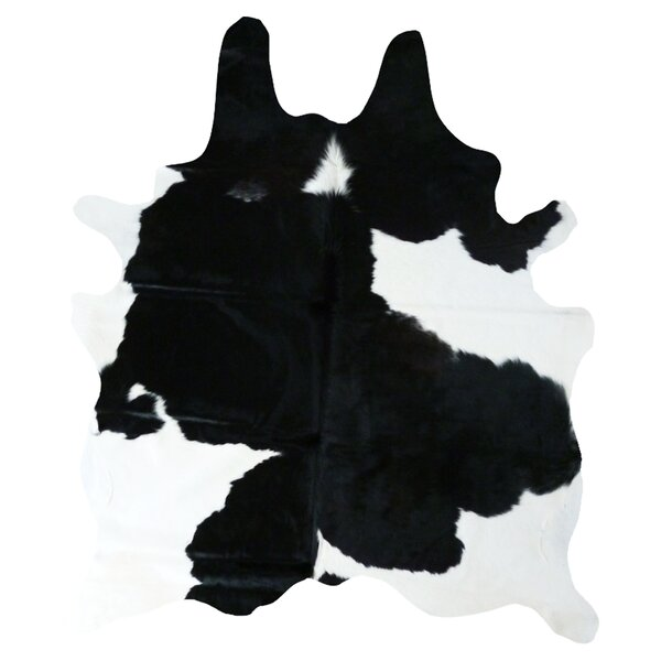 Cedarton Natural Cowhide Black/White Area Rug by Wade Logan
