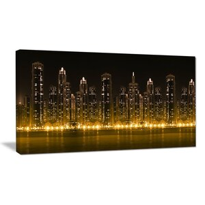 Modern City with Illuminated Skyscrapers Cityscape Photographic Print on Wrapped Canvas by Design Art