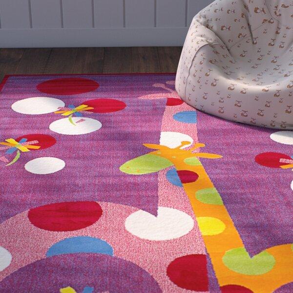 Luann Red Giraffe Area Rug by Zoomie Kids