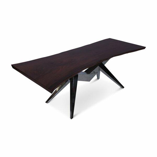 Tevis Dining Table by Orren Ellis
