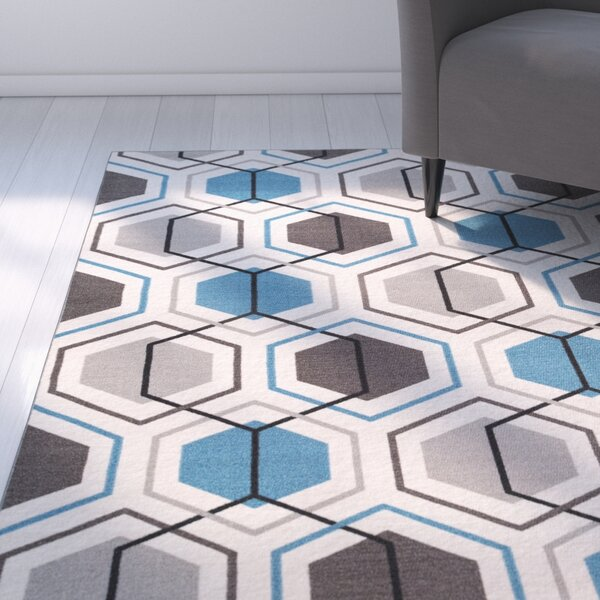 Princess Geometric Stripe Blue Area Rug by Zipcode Design