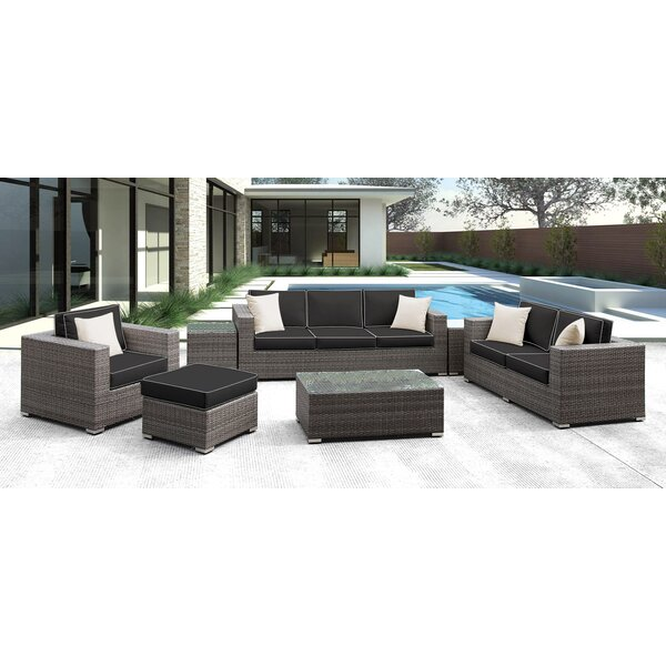 Coast 11 Piece Rattan Sectional Seating Group with Cushions by Solis Patio