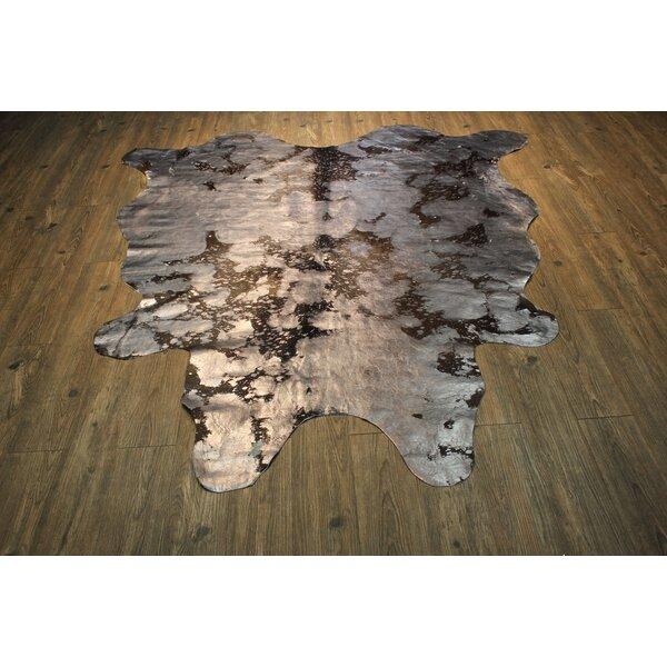 Augustine Hand Woven Cowhide Metallic Silver/Black Area Rug by Bloomsbury Market