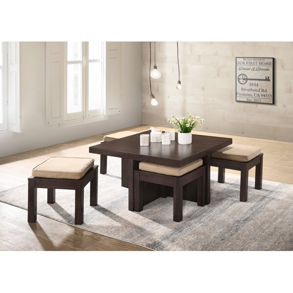Mercedes Coffee Table with 4 Nested Stools by World Menagerie