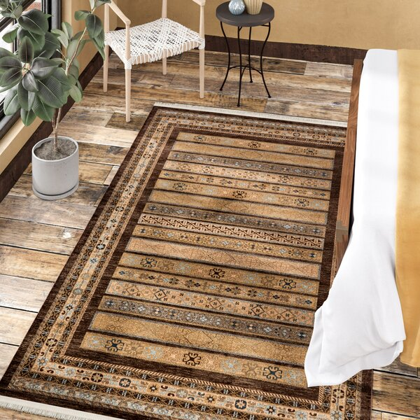 Foret Noire Brown Area Rug by World Menagerie