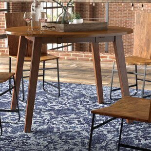 Find a Caracara Round Dropleaf Extendable Dining Table ByTrent Austin Design