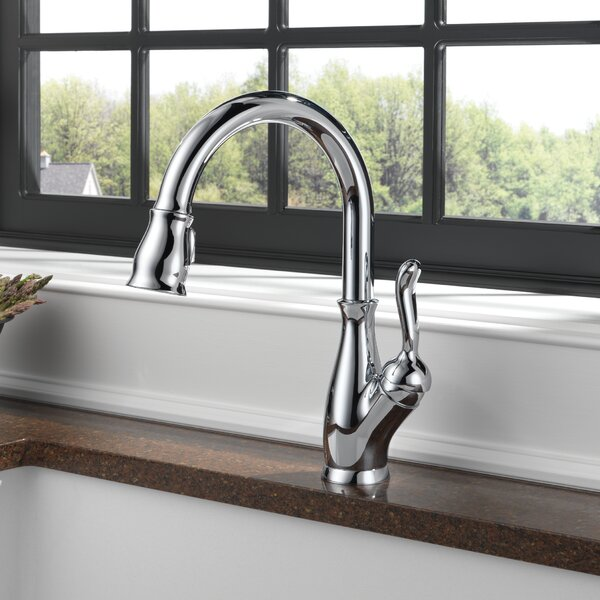 Leland Pull Down Single Handle Kitchen Faucet with MagnaTite® Docking and Diamond Seal Technology by Delta