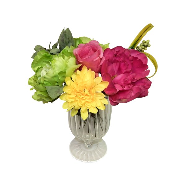 A Burst of Colors Footed Floral Arrangement in Glass Vase by Winston Porter