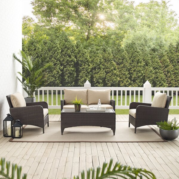 Mosca 4 Piece Rattan Sofa Seating Group with Cushions by World Menagerie World Menagerie