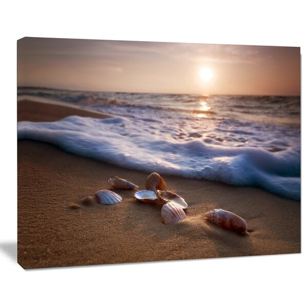Waves Approaching Seashells on Sand Photographic Print on Wrapped Canvas by Design Art