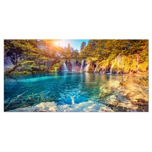'Turquoise Water and Sunny Beams' Photographic Print on Wrapped Canvas by Design Art