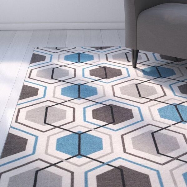 Princess Geometric Stripe Blue Area Rug by Zipcode Design
