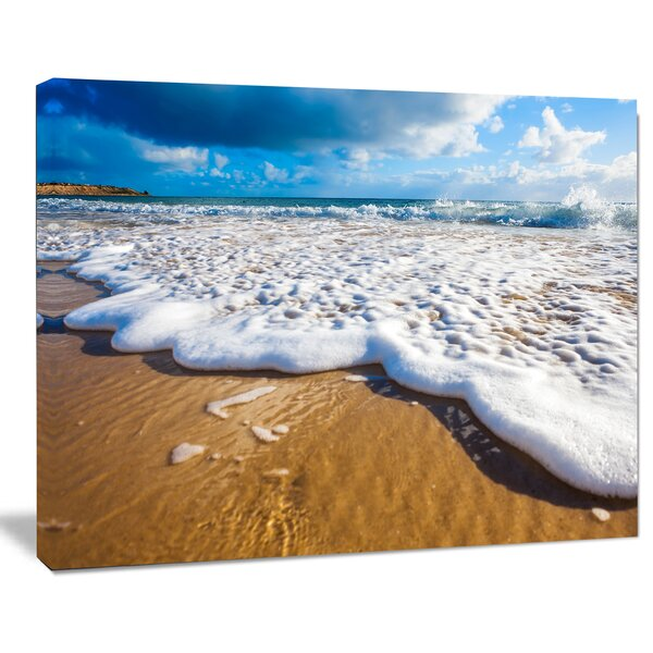 Foaming Ocean Waves on Sand Photographic Print on Wrapped Canvas by Design Art
