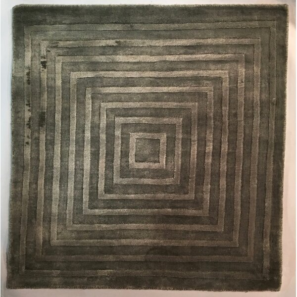 Dove Embossed Dark Gray Area Rug by Exquisite Rugs