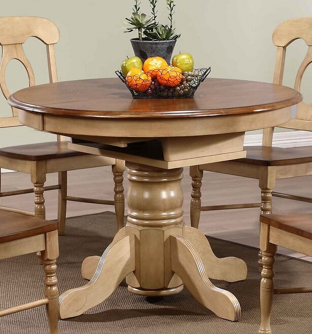 https://secure.img1-ag.wfcdn.com/im/96870695/compr-r85/3319/33190007/agrihan-extendable-dining-table.jpg