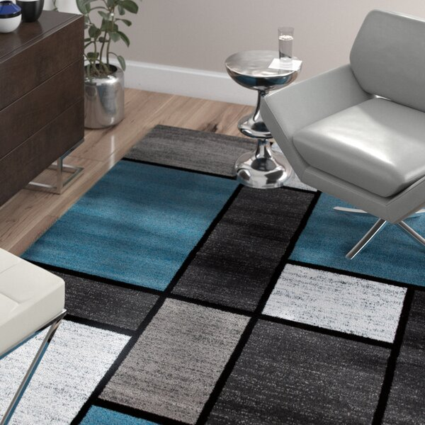 Barroso Area Rug by Wade Logan