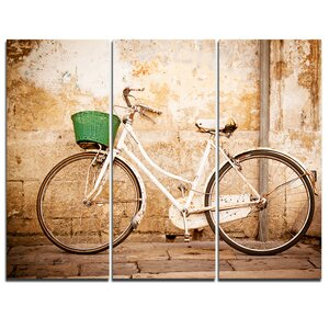 Bicycle against Wall - 3 Piece Graphic Art on Wrapped Canvas Set by Design Art