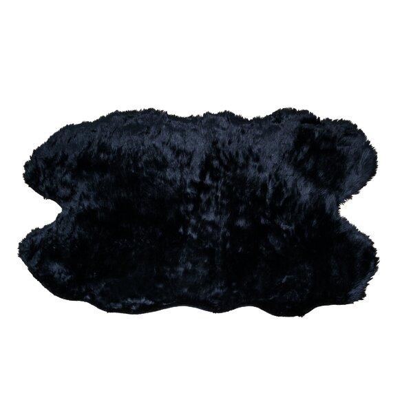 Anvi Faux Sheepskin Black Area Rug by Willa Arlo Interiors