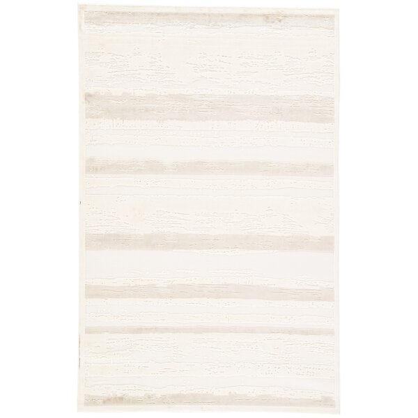 Elvis Ivory/Beige Area Rug by Wade Logan
