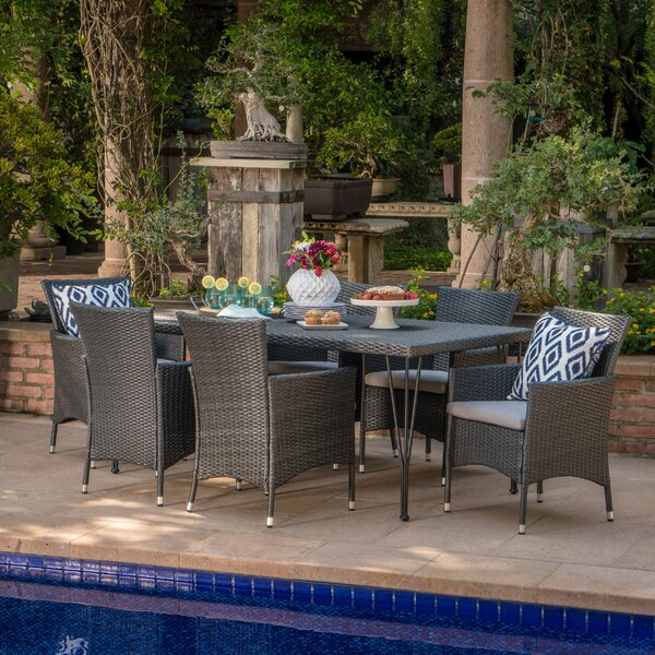 Alassane Outdoor Wicker 7 Piece Dining Set with Cushions by Ophelia & Co.