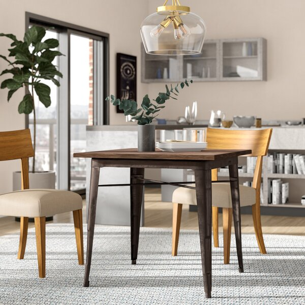 Charlsie Dining Table by Zipcode Design